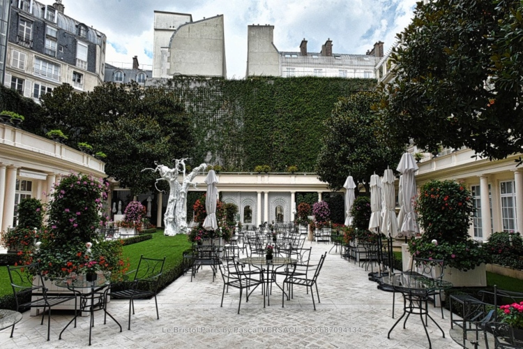 The courtyard at the Le Bristol hotel, one of the luxury family friendly hotels in Paris