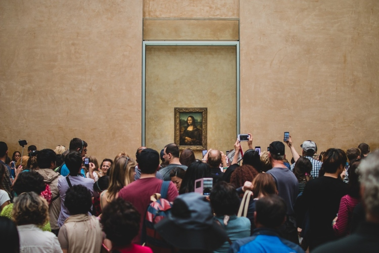 The Mona Lisa, one of the things to avoid in Paris if you dislike crowds