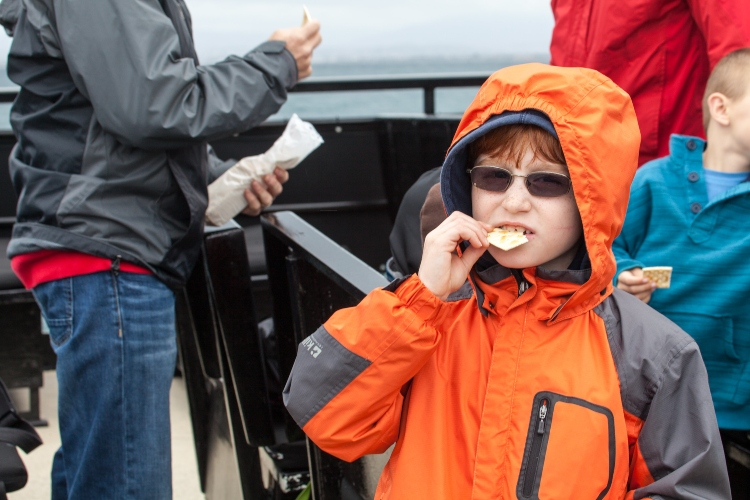 Boy eating crackers on a boat