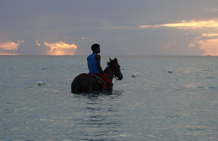 Beach horseback riding, which is one of the most popular things to do Ocho Rios